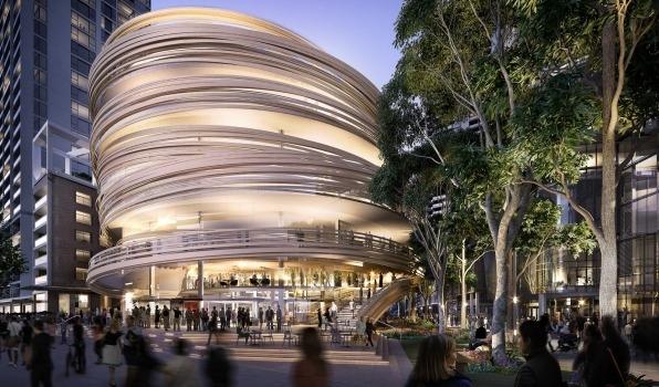 """导读 联盛(Lendlease)集团在悉尼的达令广场中心将建一个有木围栏的圆塔——""""达令交流中心""""。 该建筑将不用于办公室或公寓,里面有悉尼市图书馆、儿童托保中心、零售市场、餐馆和酒吧等。圆塔由日本Kengo Kuma建筑公司设计。 据澳洲金融观察报导,对联盛公司来说,建这样一个社区建筑还是首次,公司总裁麦肯(Steve McCann)说:""""我们真诚希望'达令交流中心'将成为一个充满活力的本地社区中心,成为所有悉尼人和游客"""